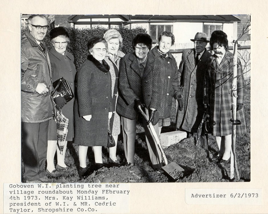 PH-G-1-11 Women's Institute planting tree near village roundabout, 4 Feb 1973